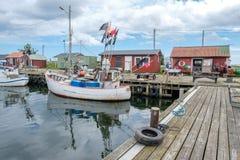 Fishing harbor in Sweden. Bläsinge, Sweden - July 12, 2017: Bläsinge harbor on the east coast of Swedish Baltic sea island Öland. Öland is a popular tourist Stock Photo