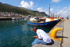 Fishing in harbour. Fishing in Kalk Bay Harbour, Cape Town Royalty Free Stock Photos