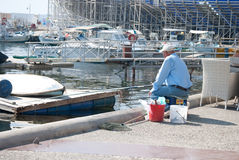 Fishing at the harbour Royalty Free Stock Image