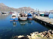 Fishing Harbour Hout Bay. Dav fishing harbour hout bay background fishingtrawler fishingharbour southafrica peer seasky royalty free stock images