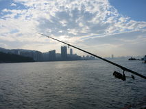 Fishing at a Harbour. A fishing rod in the air at Victoria Harbour in Hong Kong stock photos