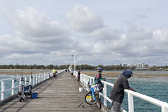 Fishing in Harvey Bay. People enjoying recreational fishing from the pier in Harvey Bay, Australia Royalty Free Stock Photography