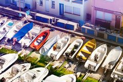 Fishing haven the Vallon des Auffes in Marseille. Famous fishing haven the Vallon des Auffes with its colorful cabins, boats and yachts at sunny day, Marseille stock photography