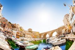Fishing haven the Vallon des Auffes at sunny day. Fish-eye picture of fishing haven the Vallon des Auffes with boats and yachts at sunny day, Marseille, France royalty free stock photography