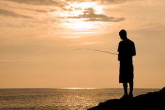 Fishing In Hawaii at Sunset Royalty Free Stock Photography