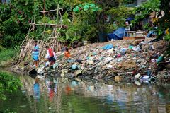 Fishing in Ho Chi Minh City, Vietnam. Fishing in polluted river in Ho Chi Minh City, Vietnam Stock Image