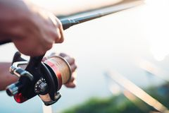 Fishing, hobby and recreational concept - fishermen. Sports Royalty Free Stock Photography