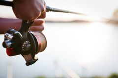 Fishing, hobby and recreational concept - fishermen. Sports royalty free stock photo