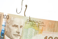 Fishing Hook and Canadian Dollar Royalty Free Stock Photography