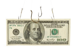 Fishing Hook and Dollar Stock Image