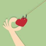 On fishing hook hanging heart. Stock Images