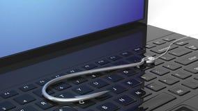 Fishing hook on laptop keyboard Stock Photos