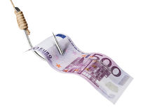 Fishing hook and money. Fishing hook piercing Euro banknote stock photo