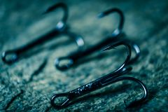 The fishing hook is photographed close-up. Place for your text.  stock photography