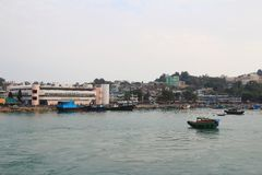 Fishing and house boats anchored in Cheung Chau harbour. Hong Kong royalty free stock photo