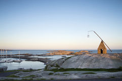 Fishing House and Harbor on Rocky Coastline of Norway Stock Photos