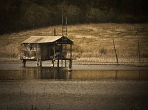 Fishing house. Hunting house. Fishing house on the water for rest and fishing. Hunting house stock photography