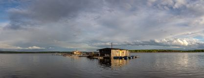 Fishing house on the lake in the evening, Russia, Ural. May royalty free stock photography