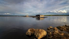 Fishing house on the lake in the evening, Russia, Ural. May stock photography