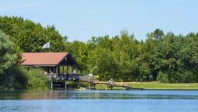 Fishing house on the lake stock image