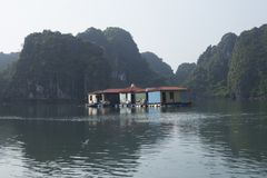 Fishing houses in Halong Bay at sunset stock photography