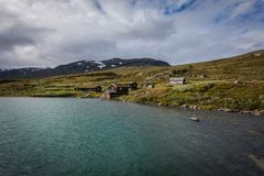 Fishing houses at the lake. Small fishing houses at the lake Russvatnet royalty free stock photography