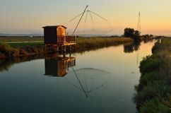 Fishing houses. At sunset in cervia, rimini. italy Royalty Free Stock Photo