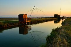 Fishing houses. At sunset in cervia, rimini. italy Royalty Free Stock Photos