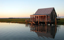 Fishing Hut on the bay. An old fishing hut along the water in Virgina. This structure appears to be barely standing, but is still used by its owner Royalty Free Stock Photo