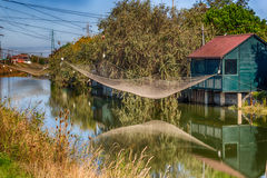 Fishing hut with fishing net Royalty Free Stock Images