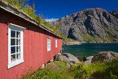 Fishing hut by fjord Stock Images