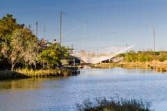 Fishing hut on lagoon Stock Photography