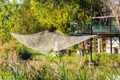 Fishing hut on lagoon Stock Images