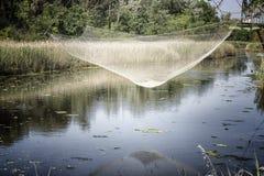 Fishing hut on the lagoon Stock Photo