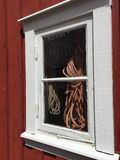 Fishing hut. With ropes in window Royalty Free Stock Photos