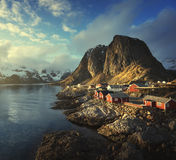 Fishing hut at spring sunset - Reine, Lofoten islands, Norway Stock Photo