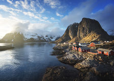 Fishing hut at spring sunset - Reine, Lofoten islands, Norway Stock Photos