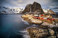 Fishing Hut Village in Hamnoy, Norway. Winter landscape with Fishing Hut Village in Hamnoy, Lofoten islands, Raine, Norway stock photo