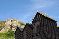 Fishing huts and East Hill, Hastings Stock Photography