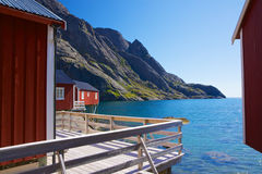 Fishing huts in fjord Royalty Free Stock Photo