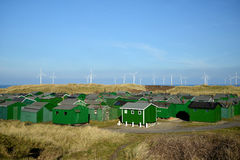 Fishing huts and Wind turbines. Fishing huts on the sandy beach and Wind turbines out at sea off the coast of Redcar Royalty Free Stock Image