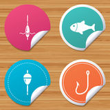 Fishing icons. Fish with fishermen hook symbol. Round stickers or website banners. Fishing icons. Fish with fishermen hook sign. Float bobber symbol. Circle Stock Photography