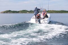 Free Fishing In Norway. Motor Boat With People Goes Fishing. Vacation Concept Stock Photography - 176945402