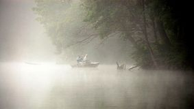 Fishing In The Fog Stock Images