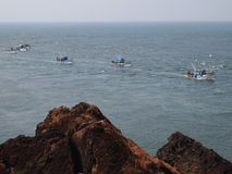 Artisanal fisheries fleet returning to port after a day's fishing, in Goa, India. Fishing in India is a major industry in its coastal states, employing royalty free stock images