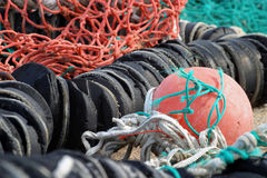 Fishing industry detail. Selectively focused nets and floats drying on a commercial fishing dock in Belmar,NJ Royalty Free Stock Image