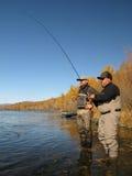 Fishing instructor Royalty Free Stock Image