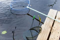 Fishing instrument on shore. Landing net and rod holders royalty free stock photos
