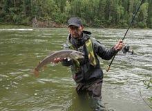 Fishing, Irkut river, Sayan mountains, Siberia, Russia, Siberian landscapes Stock Images