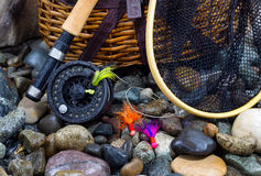 Fishing Items on Wet River Stones Royalty Free Stock Photography